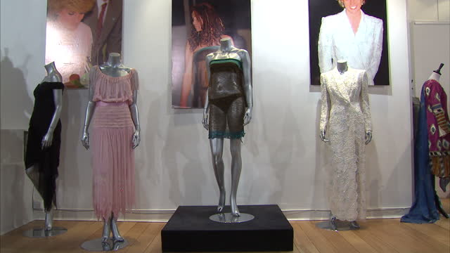 Interior shots knitted dress that was worn by Kate Middleton dresses worn by the late Princess Diana displayed on mannequins Interior shot designer...