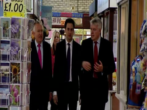 interior shots labour leader ed miliband pays a visits to a llanelli shopping centre meeting chatting with members of the public labour supporters ed... - 50 seconds or greater stock videos & royalty-free footage