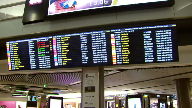 interior shots london gatwick airport departures display board on february 21, 2015 in london, england. - 2015 video stock e b–roll