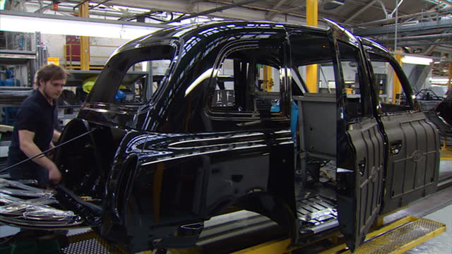 interior shots london taxi company, black cabs production line on march 26, 2015 in coventry, england. - production line worker stock videos & royalty-free footage