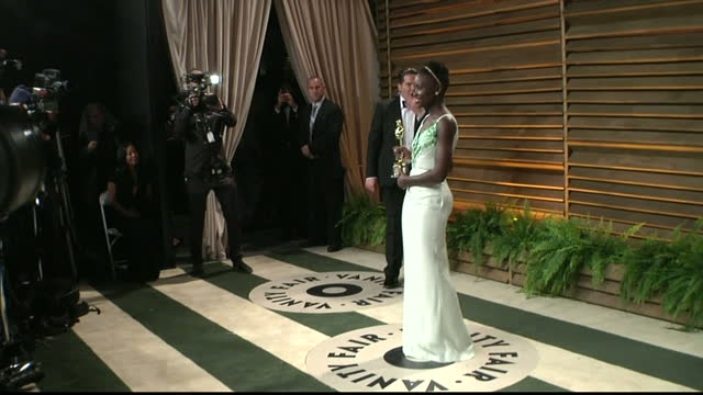 Interior shots Lupita Nyong'o posing on red carpet with her oscar on March 02 2014 in Los Angeles California