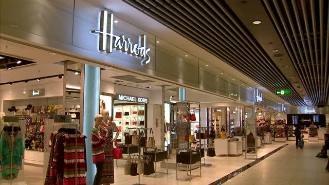 interior shots luxury, designer, shopping at gatwick airport, interior shots world duty free, kurt geiger, hugo boss, harrods stores at gatwick... - gatwick airport stock videos & royalty-free footage