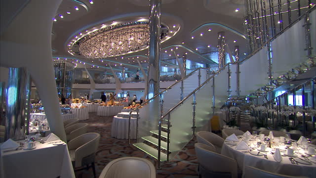 interior shots luxury dining room on board the celebrity eclipse, solstice-class cruise ship with lavish food displays. on april 23, 2010 in bilbao,... - cruise stock videos & royalty-free footage