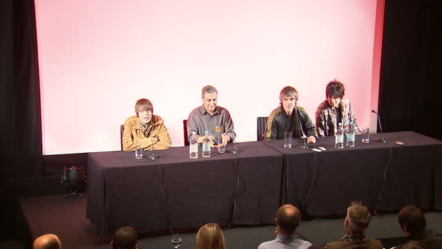 Interior shots Mani Reni Ian Brown John Squire from the Stone Rose walk into press conference sit down face the media Stone Roses Reunion Press...