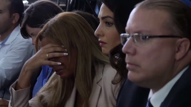 Interior shots Marwa Fahmy wife of Mohamed Fahmy jailed Al Jazeera Journalist upset in court at verdict sitting with Amal Clooney Human Rights Lawyer...