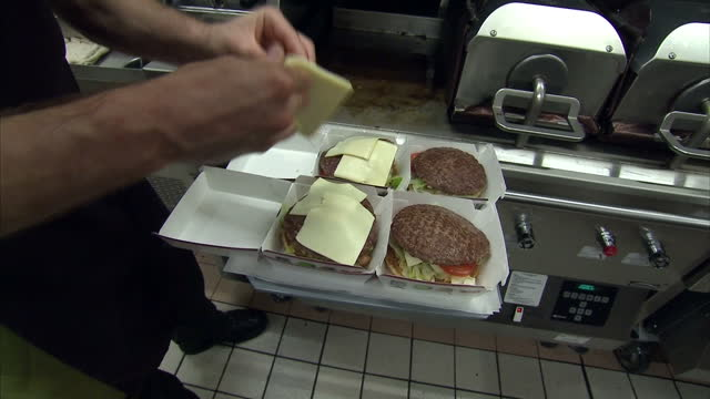 interior shots mcdonalds burgers being prepared in restaurant kitchen on june 19 2014 in london england - mcdonald's stock videos & royalty-free footage
