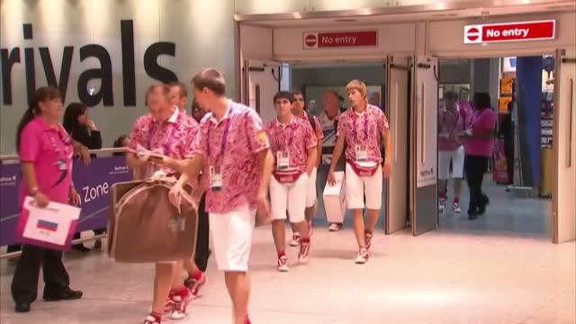 Interior shots members of the Russian Paralympian squad walks through arrivals at Heathrow Airport Interior shots large trolley full of Russian squad...