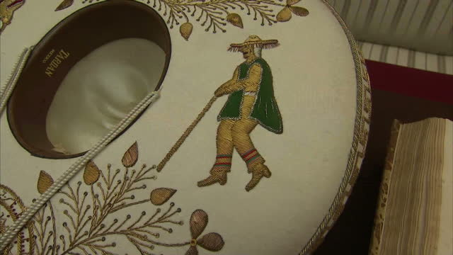 interior shots mexican items from royal collection displayed at buckingham palace including embroidered sombrero books drawings photographs handmade... - sombrero stock videos & royalty-free footage