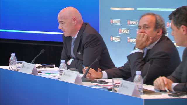 vídeos de stock, filmes e b-roll de interior shots michel platini uefa chief gianni infantino uefa secretary general pedro pinto chief of press at uefa at uefa news conference on august... - gianni infantino