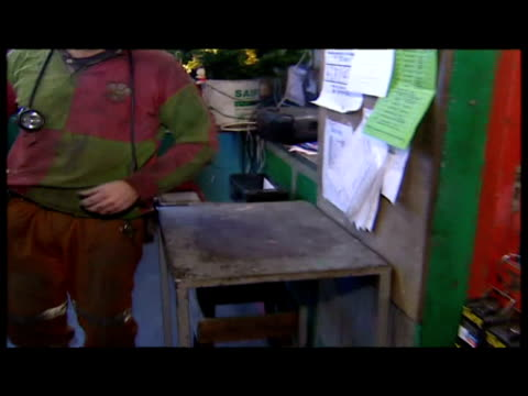 interior shots miners getting kitted up with helmets etc in crew room exterior shots wheels turning on top of mine shaft apparatus exterior shots... - mine shaft stock videos and b-roll footage
