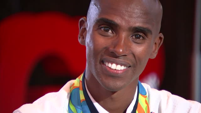 Interior shots Mo Farah Team GB Distance Runner posing with Gold Medals he won at the Rio 2016 Olympic Games in the 10000 and 5000 meter events on...