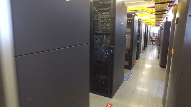 interior shots modern data center supercomputer rows of server cupboards at epsilon telecommunications on august 05 2016 in london england - network server stock videos & royalty-free footage