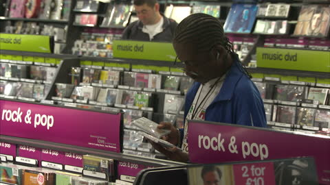 interior shots music dvd department in hmv store with shoppers perusing the various genres hmv music store interiors on august 08, 2012 in london,... - dvd stock videos & royalty-free footage