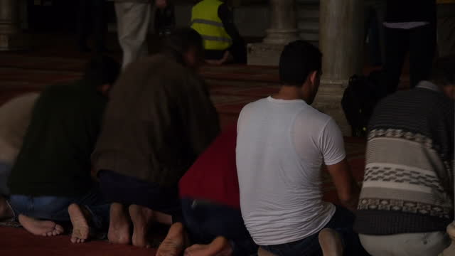 Interior shots Muslim men praying at AlAzhar Mosque on February 2 2016 in Cairo Egypt