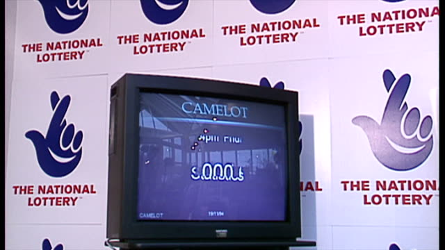 Interior shots National Lottery signage in background TV monitor displays Camelot National Lottery sales statistics on November 19 1994 in London...