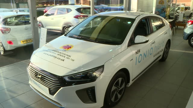 stockvideo's en b-roll-footage met interior shots new hyundai ioniq car on display in car showroom eco friendly car comes in 3 specifications hybrid electric or plugin hybrid on... - hybride voertuig