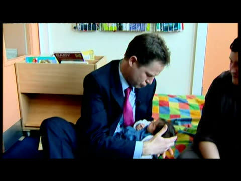 interior shots nick clegg holds baby girl in his arms speaks to parents at nursery the liberal democrats don't publish their manifesto until... - northampton stock-videos und b-roll-filmmaterial