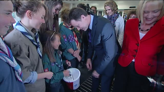 interior shots nick clegg, leader of liberal democrat party meeting scouts and donating money during campaign visit to asda in harrogate, exterior... - 2010 stock-videos und b-roll-filmmaterial