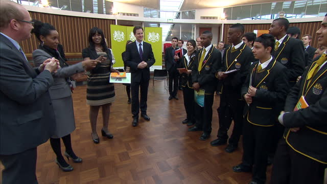 interior shots nick clegg meets chats with pupils from the globe academy poses with them for a photo call nick clegg meets children form the globe... - photo call stock videos & royalty-free footage