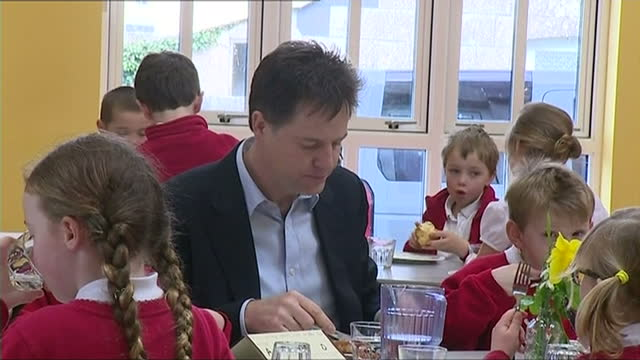 interior shots nick clegg mp eating pasty with school children at st merryn primary school on march 05 2015 in padstow england - british liberal democratic party stock videos and b-roll footage