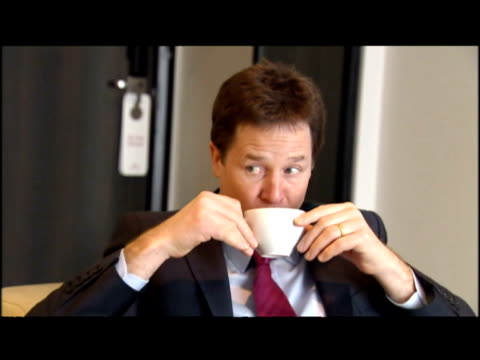 interior shots nick clegg sat on sofa drinking tea & chatting with lib dem mep edward mcmillan scott. nick clegg has issued a strong warning to the... - british liberal democratic party stock videos & royalty-free footage