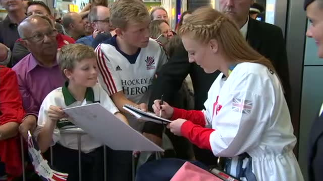 interior shots nicola white and hollie webb team gb womens hockey and gold medal winners signing autographs at heathrow airport after returning from... - field hockey stock videos and b-roll footage