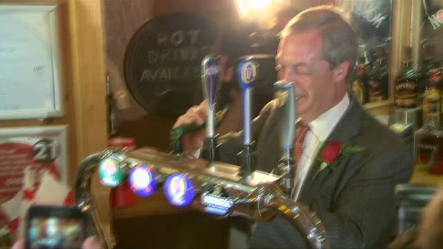 interior shots nigel farage pulls a pint to celebrate st george's day in northwood club after meeting veterans on april 23 2015 in ramsgate england - bandiera inglese video stock e b–roll