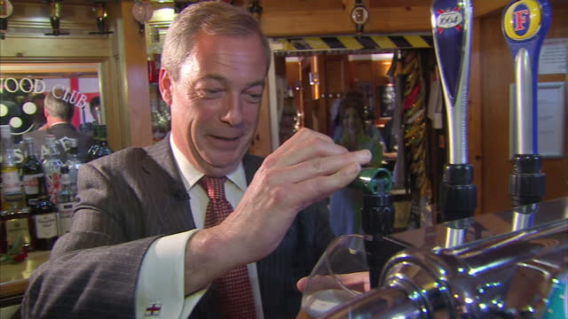 interior shots nigel farage pulls a pint to celebrate st george's day in northwood club after meeting veterans on april 23 2015 in ramsgate england - ramsgate stock videos & royalty-free footage