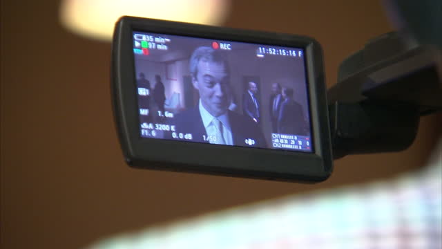 hartlepool interior shots nigel farage speaking with unknown man and talking to camera during interview with cutaways to camera display - イングランド カウンティ・ダラム点の映像素材/bロール