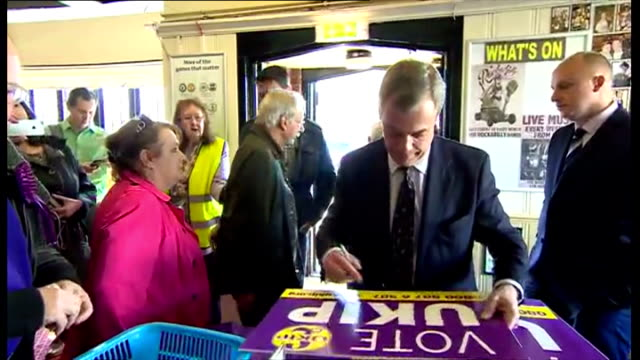 interior shots nigel farage ukip leader meeting supporters members of sublic and signing ukip posters in ramsgate on april 18 2015 in ramsgate england - ramsgate stock videos & royalty-free footage