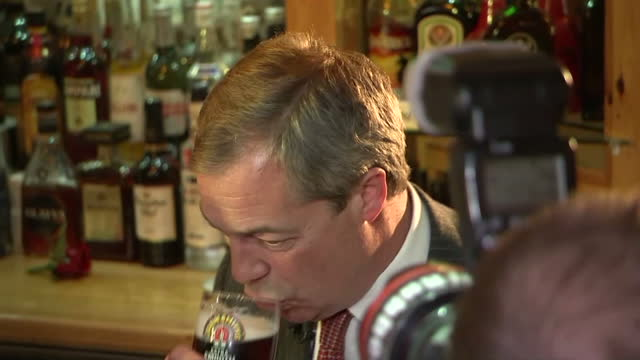 interior shots nigel farage ukip's leader drinks a pint of beer to celebrate st george's day in the northwood club on april 23 2015 in ramsgate... - ramsgate stock videos & royalty-free footage
