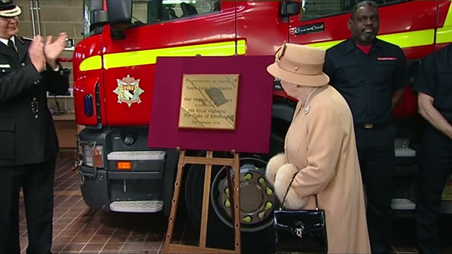interior shots nigel williams chief fire officer welcomes queen elizabeth ii and prince philip / queen reveals the plaque on easel - staffelei stock-videos und b-roll-filmmaterial