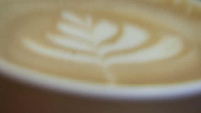 Interior shots of a barista making at espresso machine and steaming milk on March 30 2017 in London England