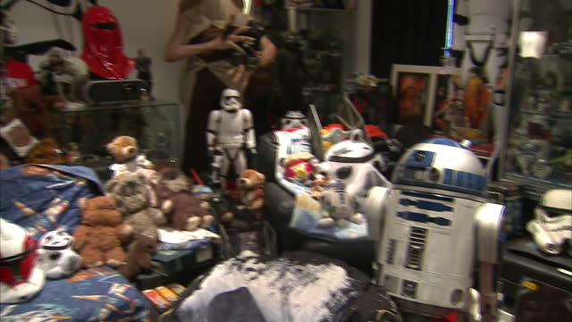 interior shots of a bedroom filled with star wars toys and memorabilia including a fullsize statue of jar jar binks and r2d2>> on december 20 2015 in... - bury st edmunds stock videos & royalty-free footage