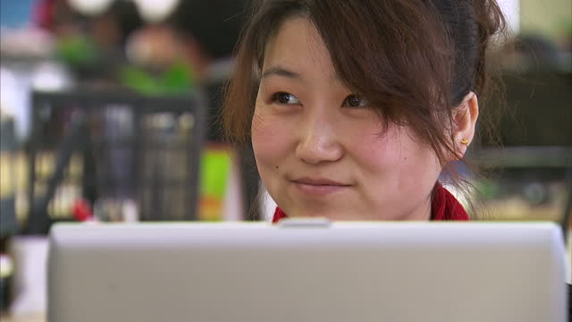 interior shots of a beijing internet cafe with young people sat at public internet terminals using computers to access internet sites on march 23,... - censorship stock videos & royalty-free footage