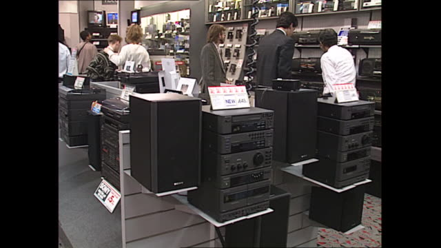 interior shots of a branch of electrical retailer dixons with customers browsing various tv's computers etc on display on 21 october 2019 in london... - stereo stock videos & royalty-free footage