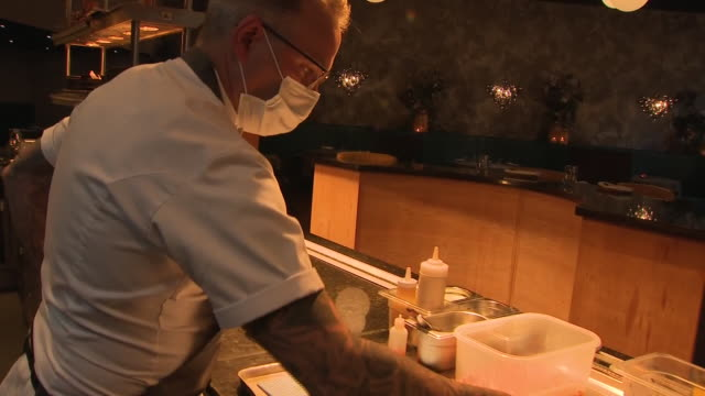 interior shots of a chef working in the kitchen of wood restaurant preparing dishes, wearing a face mask on 9 october 2020 in manchester, united... - chef stock videos & royalty-free footage