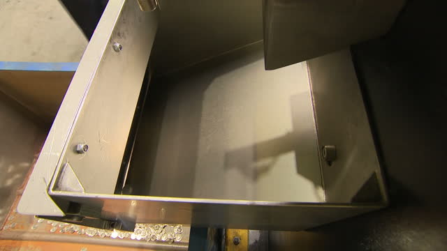 interior shots of a chute in the royal mint as the one billionth new one pound coin tumbles into it on 10 july 2017 in llantrisant united kingdom - money press stock videos & royalty-free footage