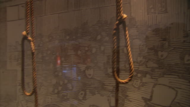 interior shots of a collection of hangman's nooses on display at the crime museum uncovered exhibition at the museum of london>> on october 07 2015... - hangman stock videos and b-roll footage