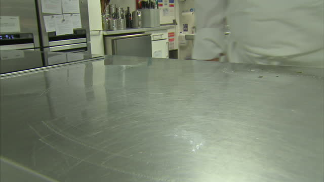 interior shots of a cook wiping down kitchen surfaces after preparing chicken.>> on november 27, 2014 in london, united kingdom. - campylobacter stock videos & royalty-free footage