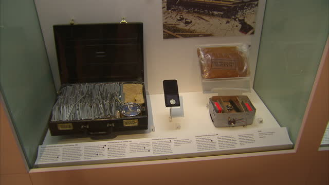 interior shots of a display containing pictures and objects related to the 1982 hyde park and regent's park bombings including a replica of the nail... - four objects stock videos & royalty-free footage