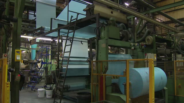 interior shots of a factory producing plastic refuse sacks made from recycled polythene including shots of sheets of brightly coloured plastic being... - polyethylene stock videos and b-roll footage
