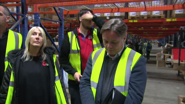 interior shots of a group of mp's including anna turley and ian wright being shown around the sports direct warehouse on a tour on november 07 2016... - ian wright stock videos and b-roll footage