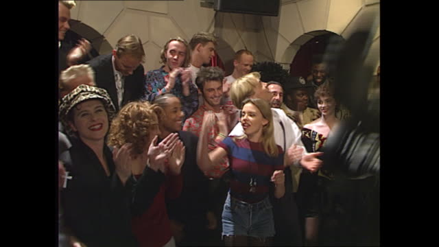 interior shots of a group of recording artists in studio applauding themselves after a recording of band aid the charity single in aid of ethiopia... - pop music stock-videos und b-roll-filmmaterial