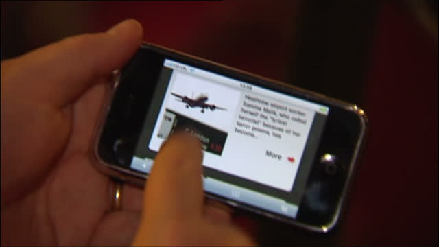 interior shots of a hand holding an original apple iphone and navigating around the sky news web application to view news stories on 8 november 2007... - 2007 stock videos & royalty-free footage