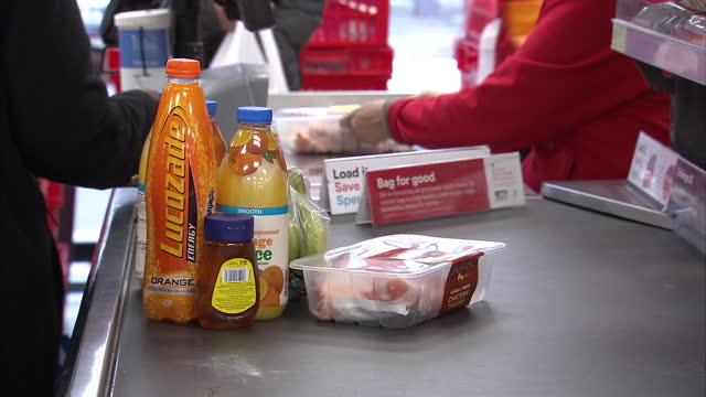 interior shots of a iceland supermarket check out worker scanning food shopping, anonymous people walking in a supermarket and household items on the... - group of objects stock videos & royalty-free footage
