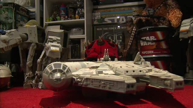 interior shots of a model millennium falcon and an r2-d2 signed by kenny baker surrounded by other star wars memorabilia.>> on december 20, 2015 in... - star wars stock videos & royalty-free footage