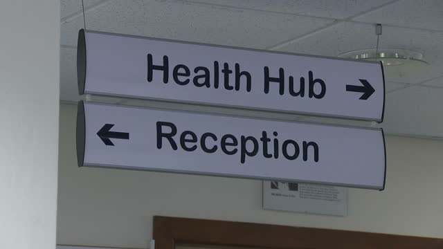 interior shots of a nearly empty gp's waiting room with signs to the health hub and reception on january 15 2017 in london united kingdom - general practitioner stock videos & royalty-free footage