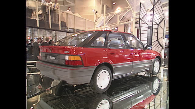 interior shots of a new rover 216 gsi and working model of an alloy engine on display at the 1989 london motor show at earls court on 18 october 1989... - alloy stock videos & royalty-free footage