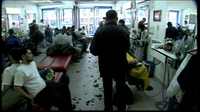 Interior shots of a New York barbers shop with Hispanic men having haircuts and beard trims on February 06 2008 in New York City